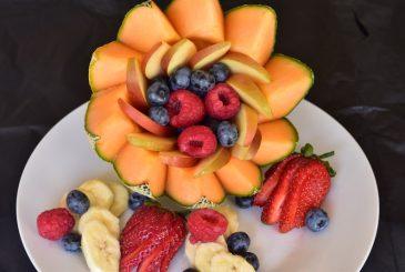 Vegan rockmelon fruit bowl apple, berries