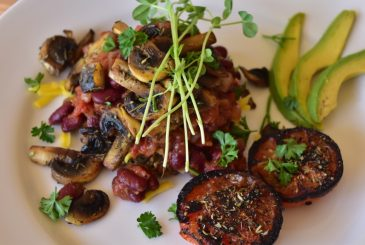 Vegan huge breakfast grilled tomato, avocado, mushrooms, vegan cheese, baked beans