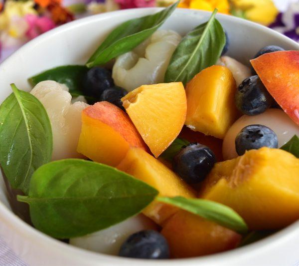 Vegan colourful basil fruit salad